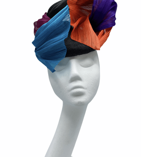 Black base headpiece with an array of silk abaca coloured detail to finish in pink, teal, purple and orange.