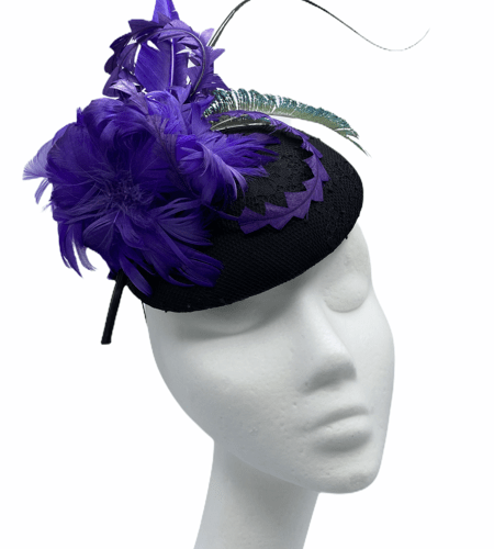 Black velvet base with purple flower finished off with peacock feather to the back.