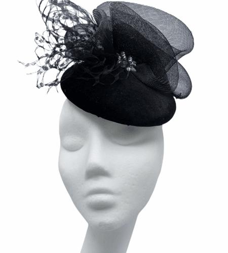 Black velvet hat with crin and net detail, black pearl inset.