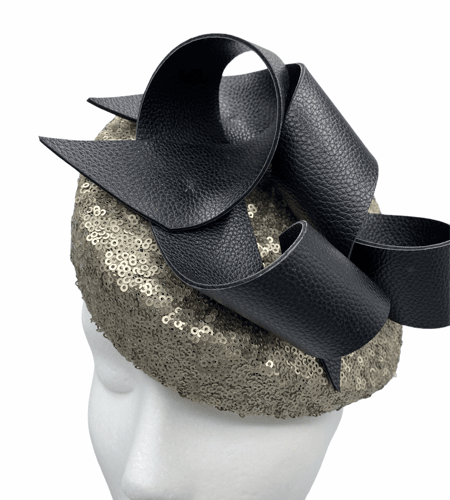 Gold sequinned shaped teardrop with black leather swirl detailing to the top.