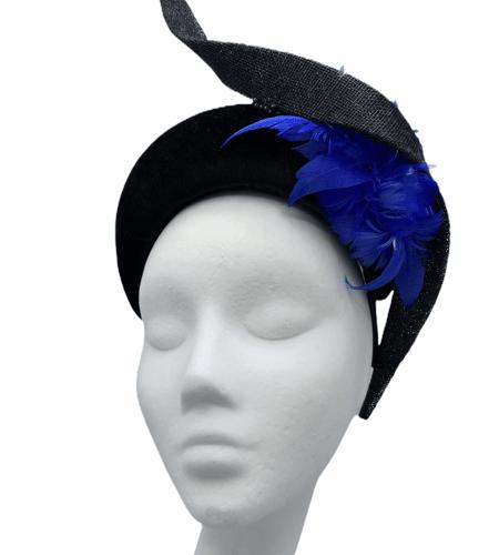 Black velvet bandeau with blue flower detail and black swirl.