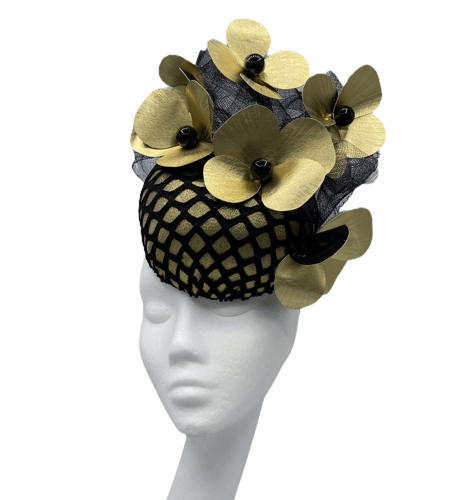 Black and gold headpiece with stunning gold flower detail.