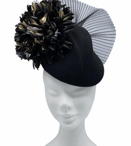 Black felt hat with gold/black flower detail.