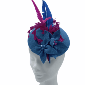 Blue felt headpiece with blue felt flowers, finished with pink and blue arrow feathers.