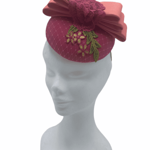 Pink small base headpiece with green & pink rose embellished detail and finished with coral top flat bow.