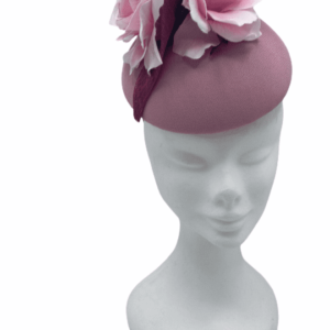 Baby pink base headpiece with baby pink flowers to the top and finished with darker pink swirl detail.