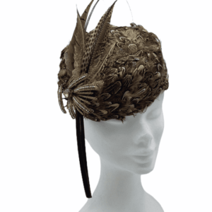 Feather encrusted headpiece with vintage brooch detail finished with beatiful feather and quill detail.