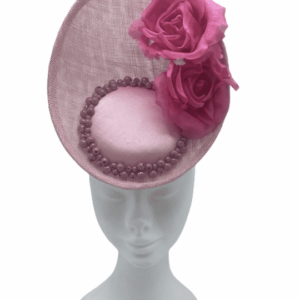 Pink frontal percher with pink satin centre surrounded by pink pearls, finished with 2 pink flowers to left side.