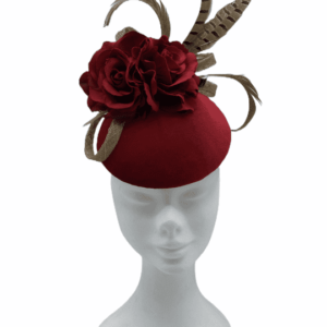 Red velvet based headpiece with red flower and finished with brown feathered detail.