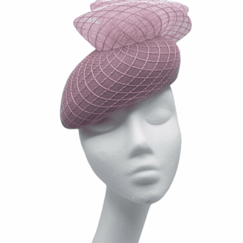 Pink larger teardrop shape headpiece, finished with swirl detail to the top.