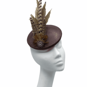 Chocolate brown base with feather detail finished off with a circular pendant to base of the feathers.