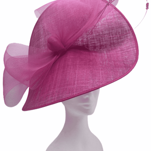 Large pink saucer headpiece on a headband, finished with big bow detail to front.