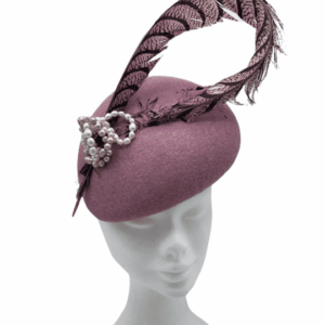 Pink felt headpiece with feathered detail.