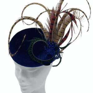 Blue velvet based headpiece with an array of coloured feathers.