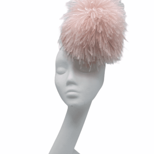 Stunning quirky baby pink small headpiece with floaty ostrich feather detail.