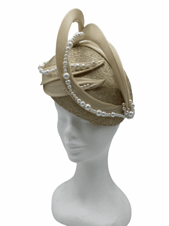 Large gold sequin teardrop headpiece with pearl detail finish.