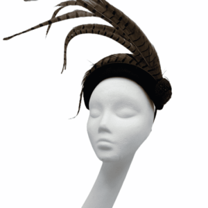 Black velvet bandeau headpiece with a spray of brown feathers.