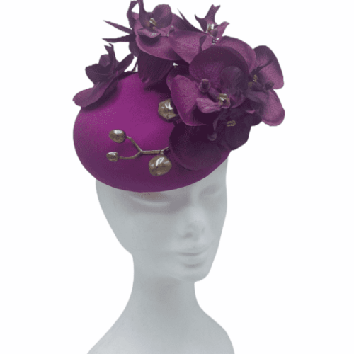 Pink magenta coloured headpiece with pink magenta orchids and gold buds.
