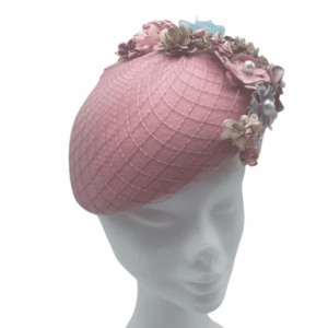 Pink teardrop headpiece with an array of coloured detail to rear of the headpiece.