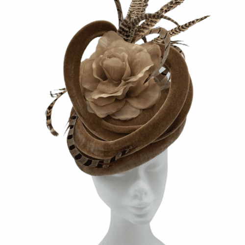 Beige/tan coloured velvet teardrop headpiece with swirl detail and completed with beautiful brown feathers.