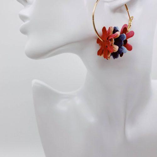 Gold hoop earrings with coloured flower detail.