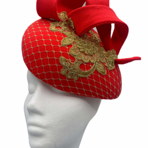 Coral red teardrop headpiece with gold embellished gold overlay.