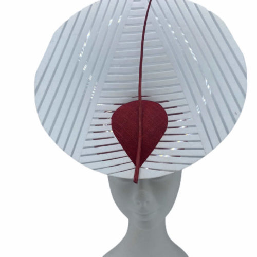 Stunning headpiece with red sinamay base and white/clear vinyl structure.