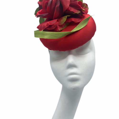 Red headpiece with red flowers covered with a green raw silk swirl.