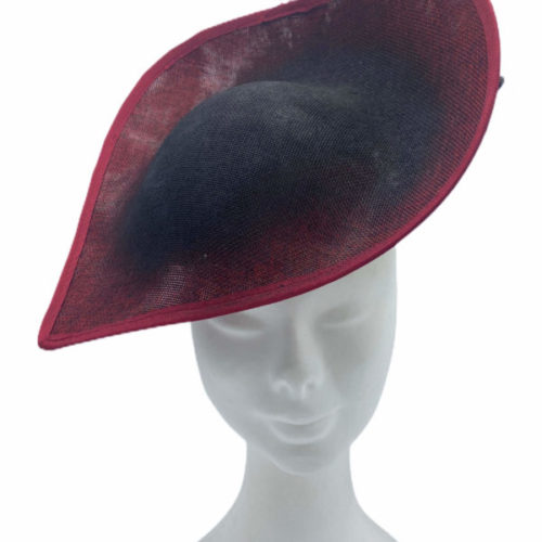 Black hat with red infusion of colour, black feather detail to opposite side.