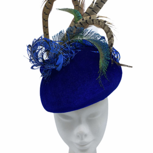 Blue velvet teardrop headpiece, finished with an array of coloured feathers.