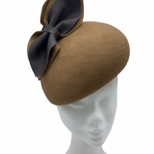 Brown felt large yeardrop headpiece with brown felt/leather bow detail.