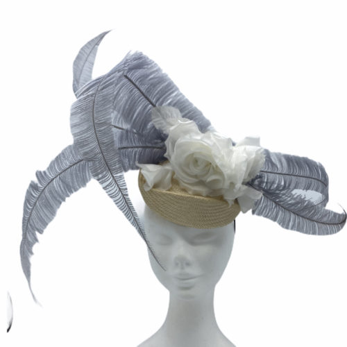 Cream/beige base with an ivory flower surrounded with an array of large silver/grey feathers.