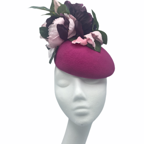 Magenta pink felt headpiece with pink/burgundy flowers and green leaf detail to finish.