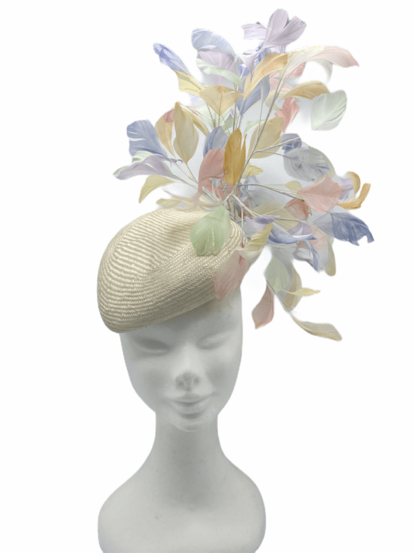 Cream teardrop headpiece with an array of individually hand dyed pastel coloured feathers.
