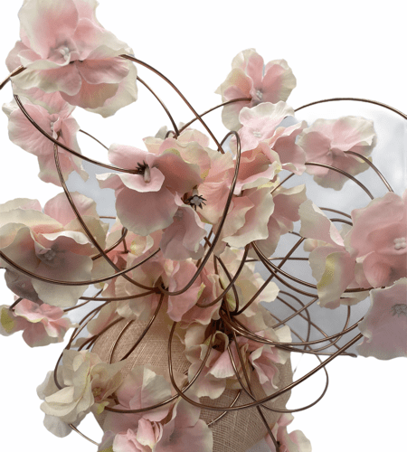 Cream/beige base with rose gold wire with an array of pink/white flowers intertwined throughout the wires.