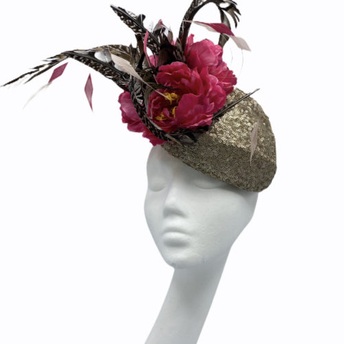 Gold sequinned headpiece with stunning feather and pink flower detail.