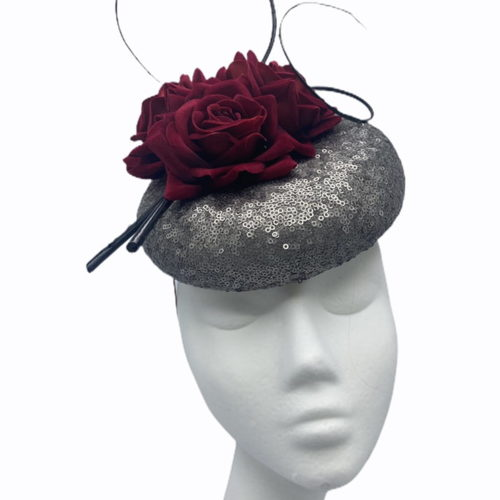 Pewter sequinned pillbox with stunning burgundy flower detail, finished with black quill swirl detail.