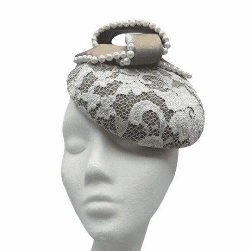 Taupe coloured headpiece with ivory lace overlay finished with stunning pearl lined swirl detail.