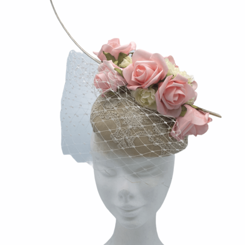 Gold satin pace with lace detail, finished with cream veiling with pink flowers on top.