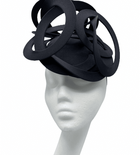 Black base with a black continuousswirl detail to the top.