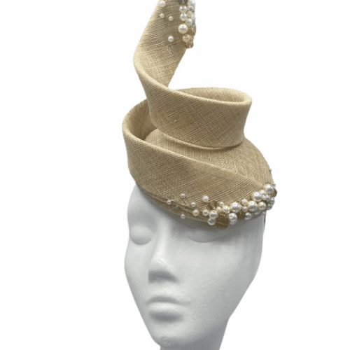 Gold pillbox hat with gold swirl detail finished with gold/ivory coloured pearl encrusted detail to the base and top of the swirl.